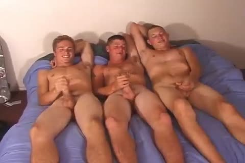 Three young fellows Rubbing Their ramrods On The bed