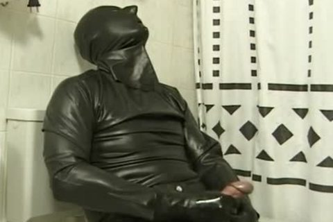 fellow In darksome Latex Catsuit Jacks Off In bathroom