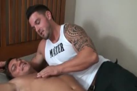 Beefy guy gets teased on bed