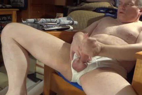 Stroking in white briefs with admirable cream flow