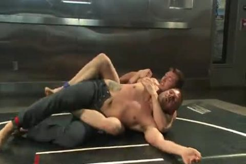 Two homosexual Wrestling And Getting in nature's garb In The Ring