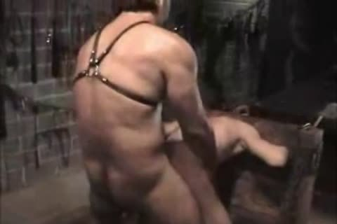 Darksome homosexual couple bang each other in dungeon