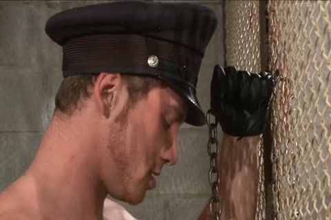sadomasochism - Officer Dominates The Inmate.