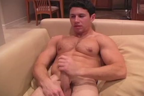 This darksome Haired meaty lad Enjoys His wank