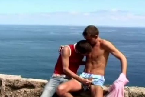 Concupiscent homosexual teens engulfing penis outside by the ocean