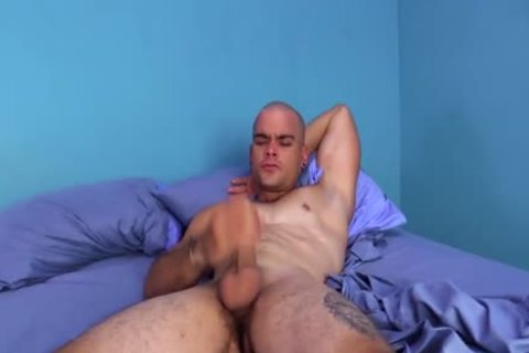 Big penis latino urbano stroking his uncut meat