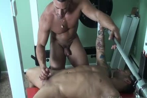 Muscle bodybuilder fastened with cumshot