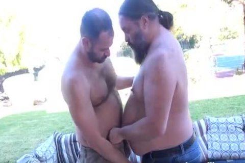 Leather clad butch homosexual hunks drink fat cock