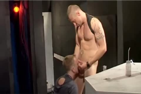 White chap gargling off charcoal rods at gloryhole