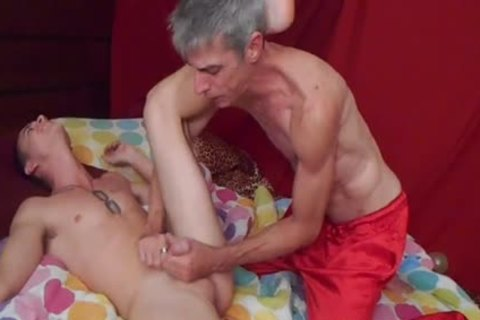 Tattooed boy getting tickled hard