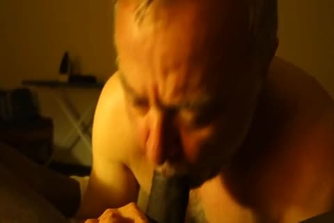 Bearded grand-dad engulfing Verbal darksome guy's cock (1)